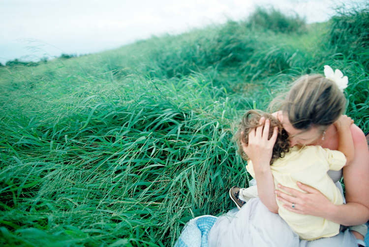 maui photographer wendy laurel's image of mom hugging her son in fields