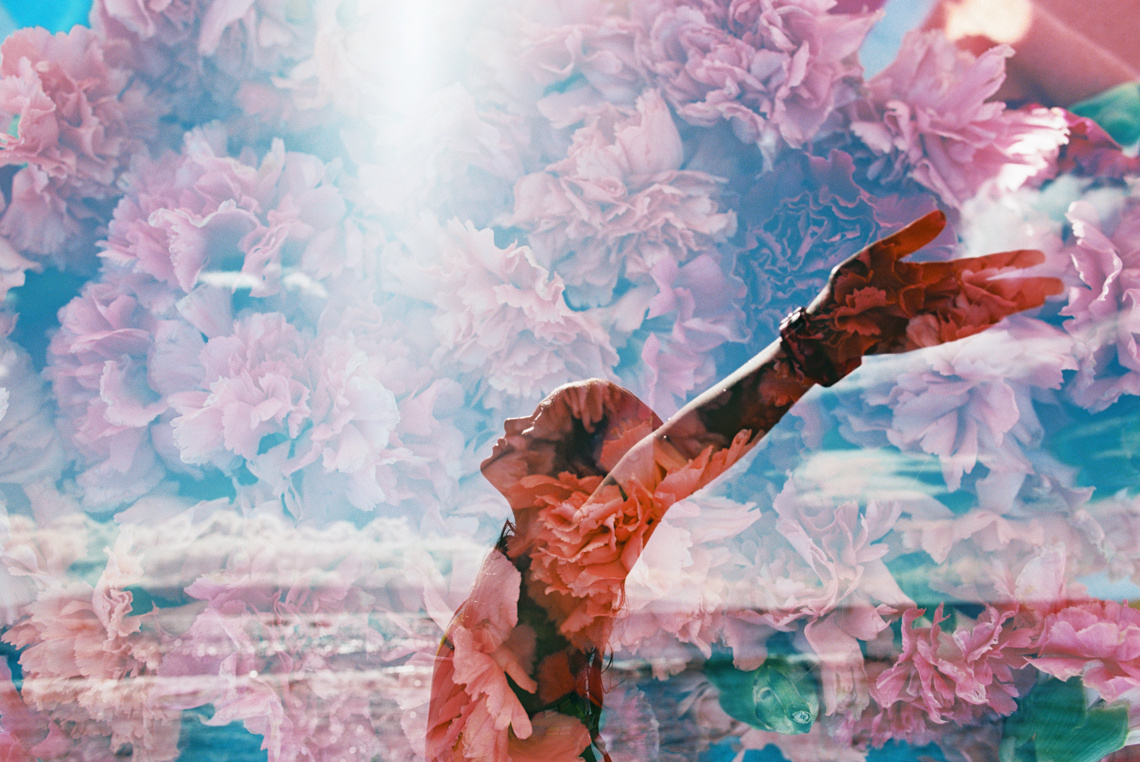 double exposure on film of girl with hands up and flowers and joy-1
