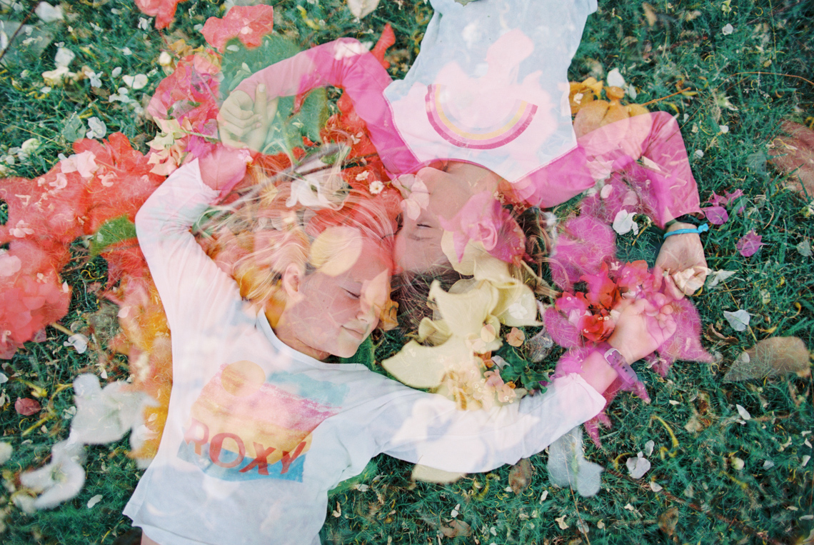double exposure on film of two girl holding hands and flowers by wendy laurel-1