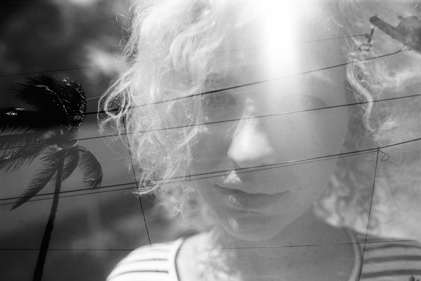 double exposure wtih telephone lines and girls face
