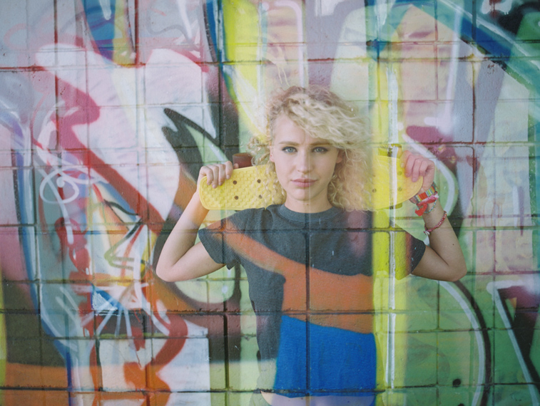 double exposure with girl wtih skate nad graffiti