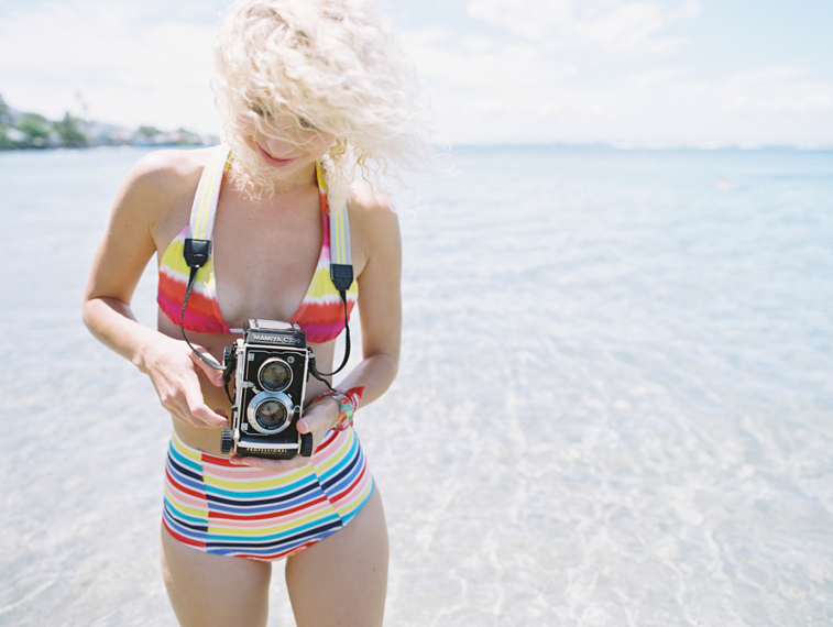 girl in rainbow bikini holding mamiya c220 camera twin lens