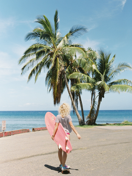 girl with skate and surfbaord by maui photographer wendy laurel