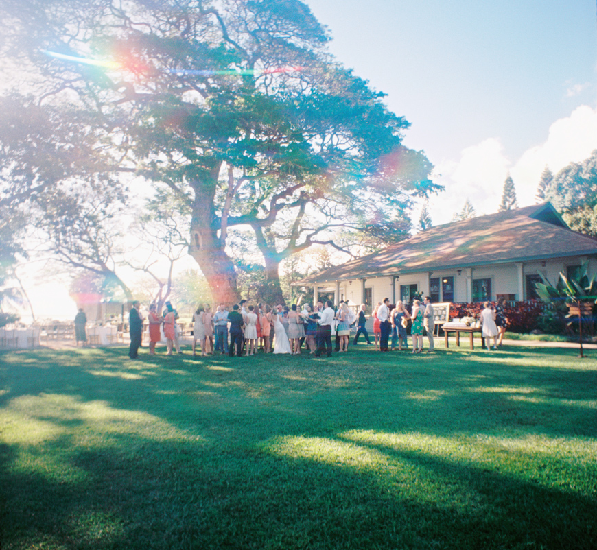 rainbow effect group shot at olowalu plantation house wedding on maui