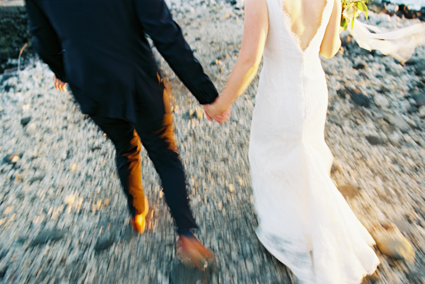 bride and groom walking motion image at sunset on maui