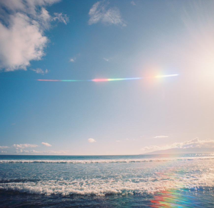 rainbow streaks over ocean image by maui photographer wendy laurel