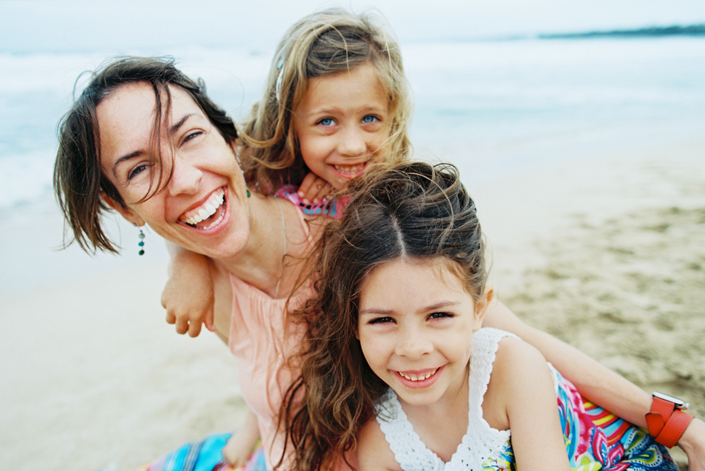 family that plays together stays together on ironwoods beach in kapalua by maui family photographer wendy laurel