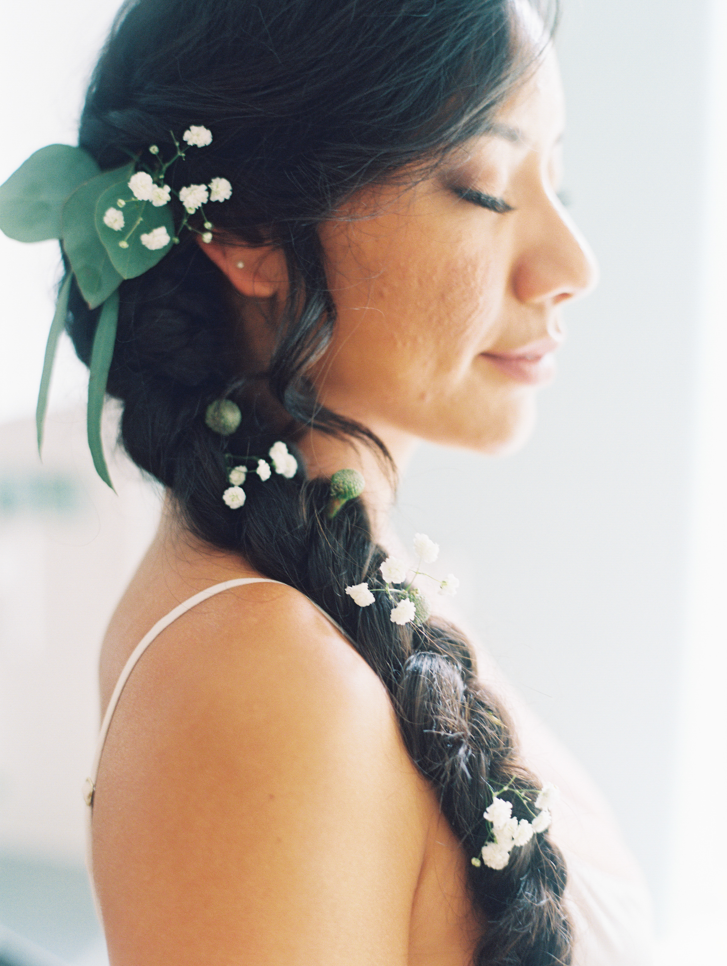 bridesmaid with baby breath in hair featured on brides.com by maui photographer wendy laurel