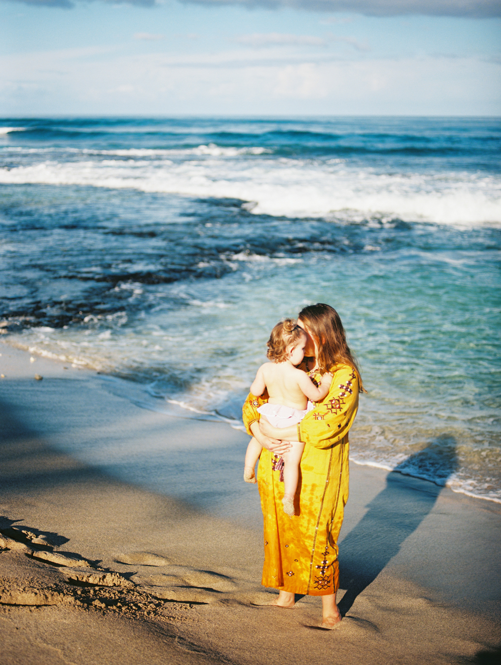 mom and daughter by ocean photo on film by maui photographer wendy laurel