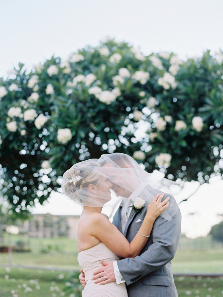maui wedding photographer wendy laurel's image of couple with veil kissing-1