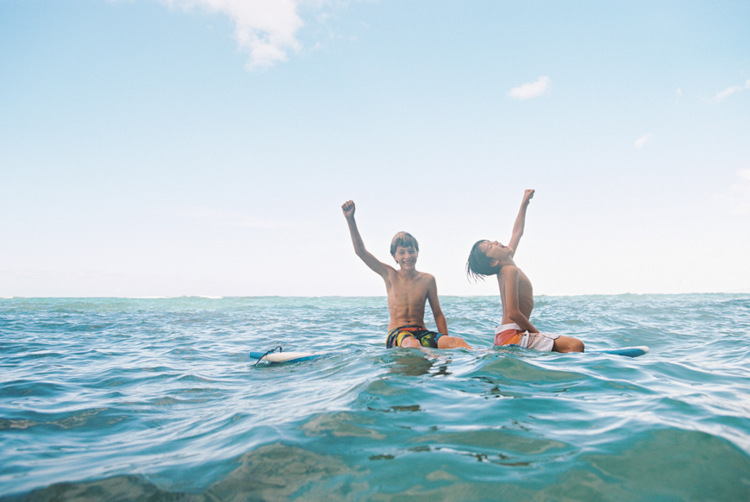 maui photographer wendy laurel's image of boys on surfboards with joy