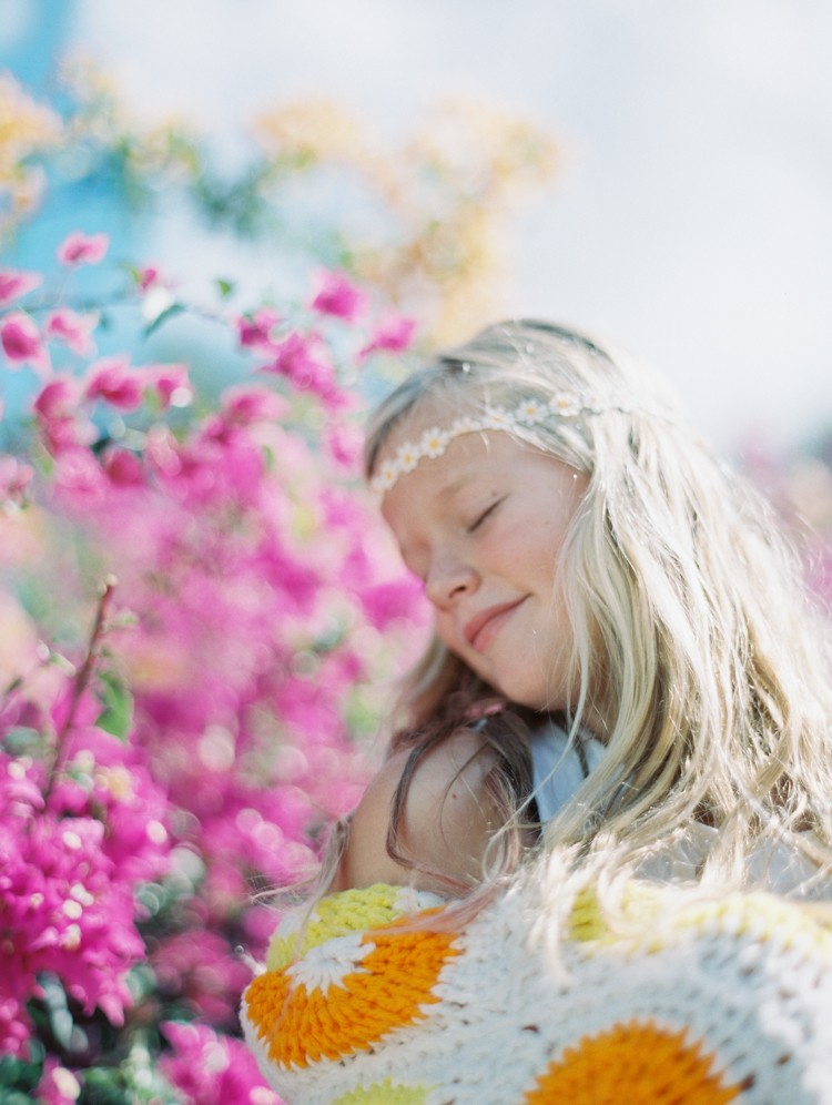 maui photographer wendy laurel's film images of girl in yellow and orange quilt with flower headband-1