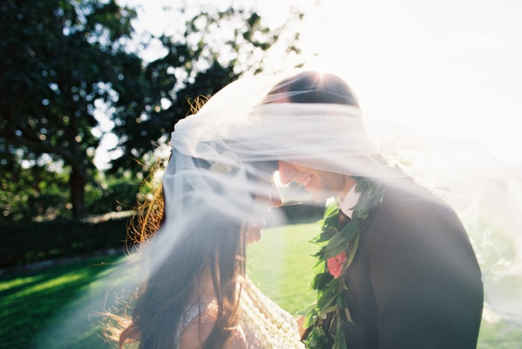 bride and groom under veil image by maui photographer wendy laurel