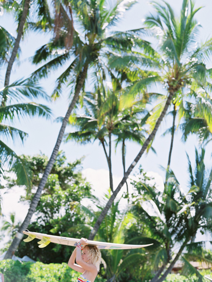 girl with surfboard and palm trees by hawaii photogrpaher wendy laurel
