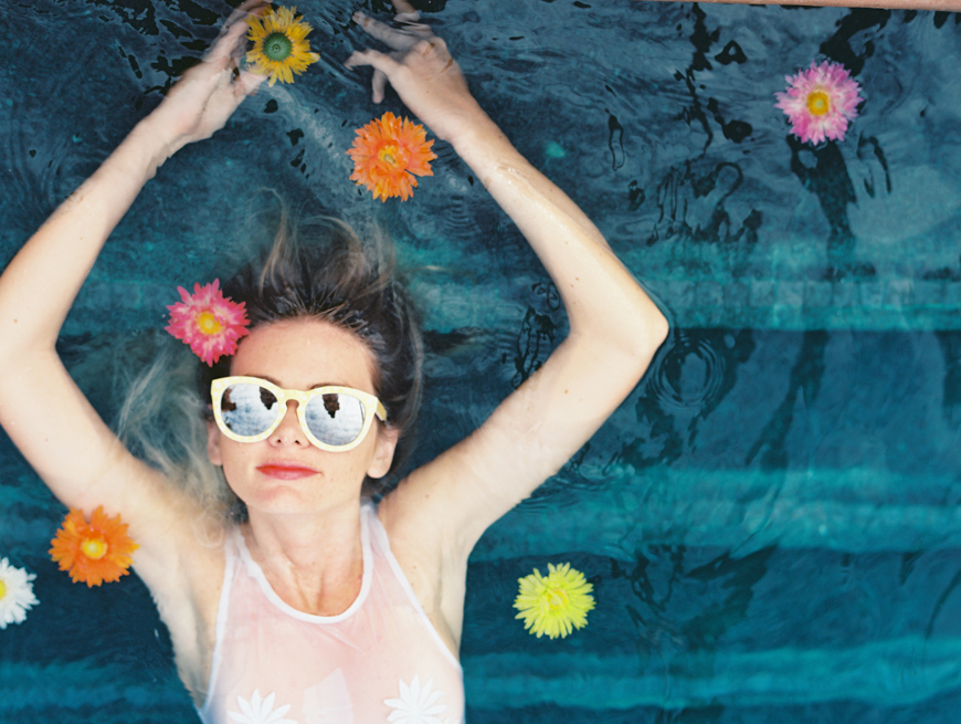 wendy laurel photo of girl in pool with bright flowers