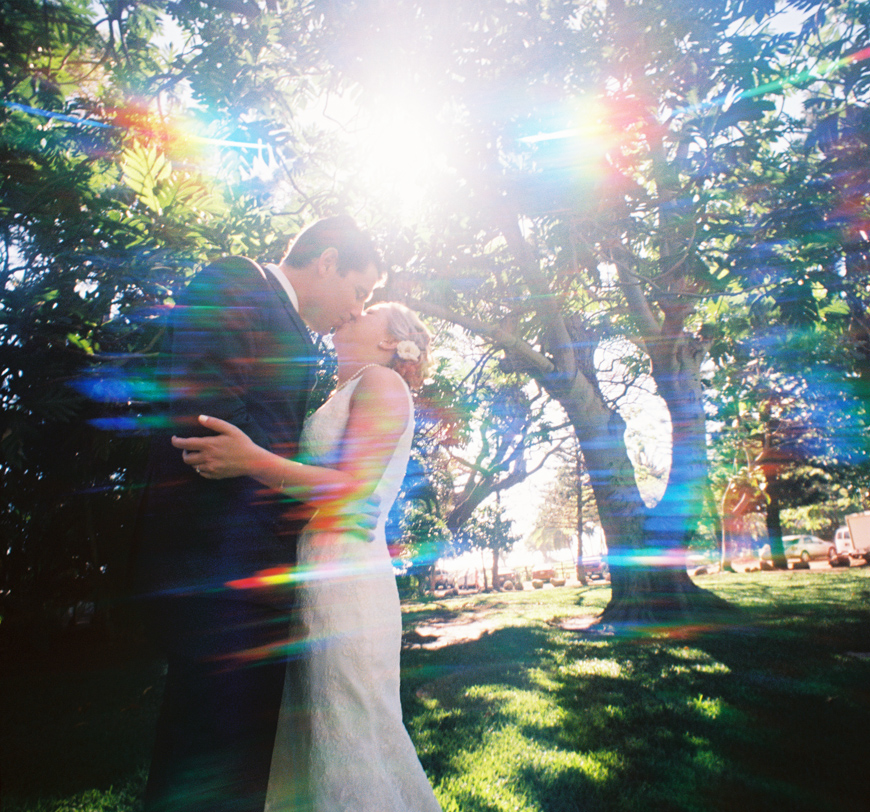 rainbow effect image of bride and groom by maui photographer wendy laurel