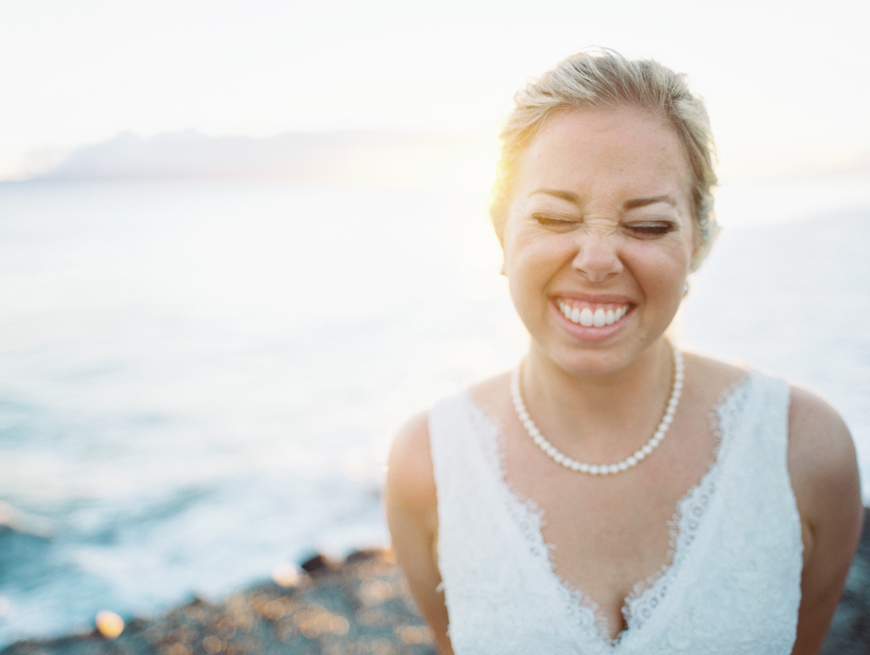 bride giggling at sunset by maui photographer wendy laurel