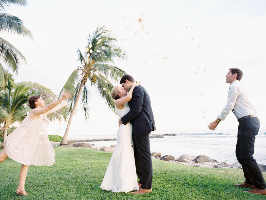 throwing flowers at bride and groom at olowalu plantation house image