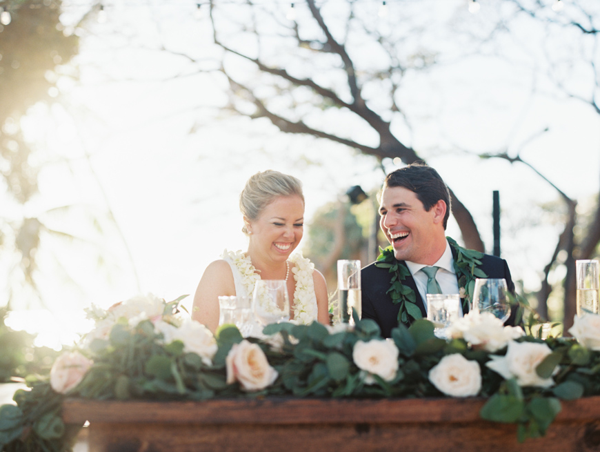 bride and groom laughing at toasts at olowalu plantation house reception