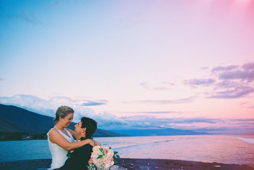 purple sunset bride and groom image at olowalu plantation house wedding