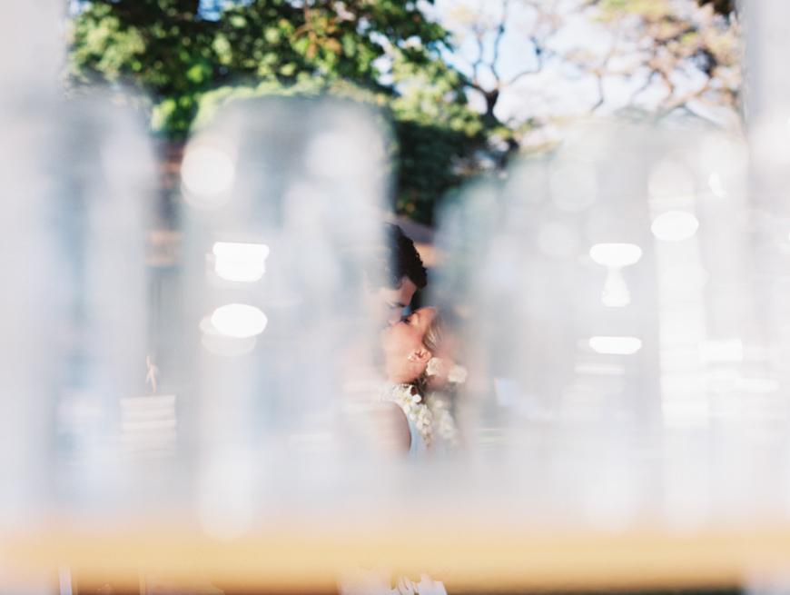 bride nad groom shot between water glasses by maui photographer wendy laurel