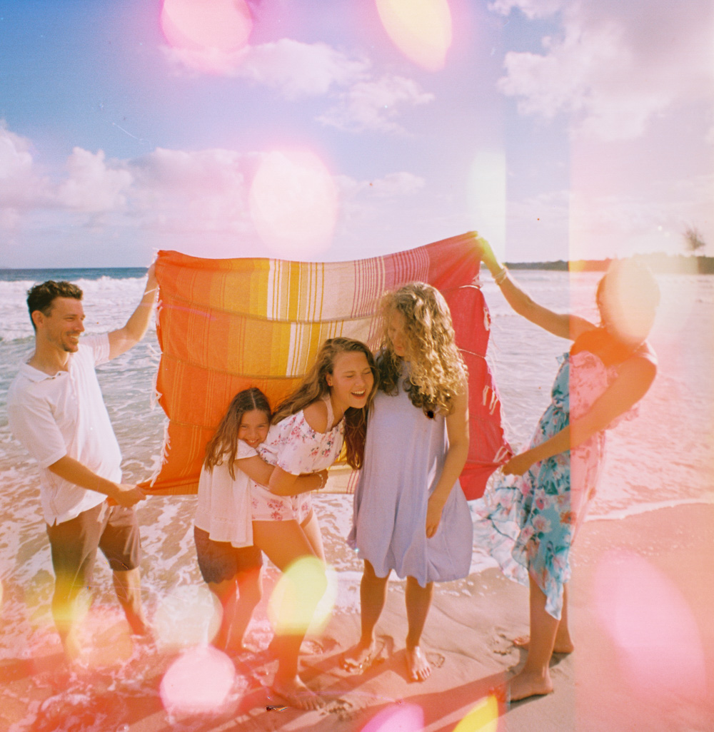 fun and colorful artistic maui family photography with film at kapalua beach in lahaina maui by hawaii photographer wendy laurel
