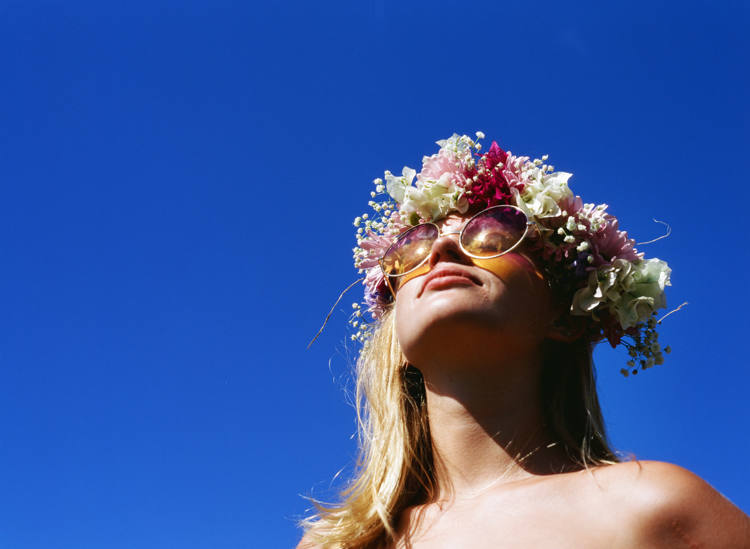 Photo of girl in flower crown on Kodak E100 by hawaii photographer Wendy Laurel