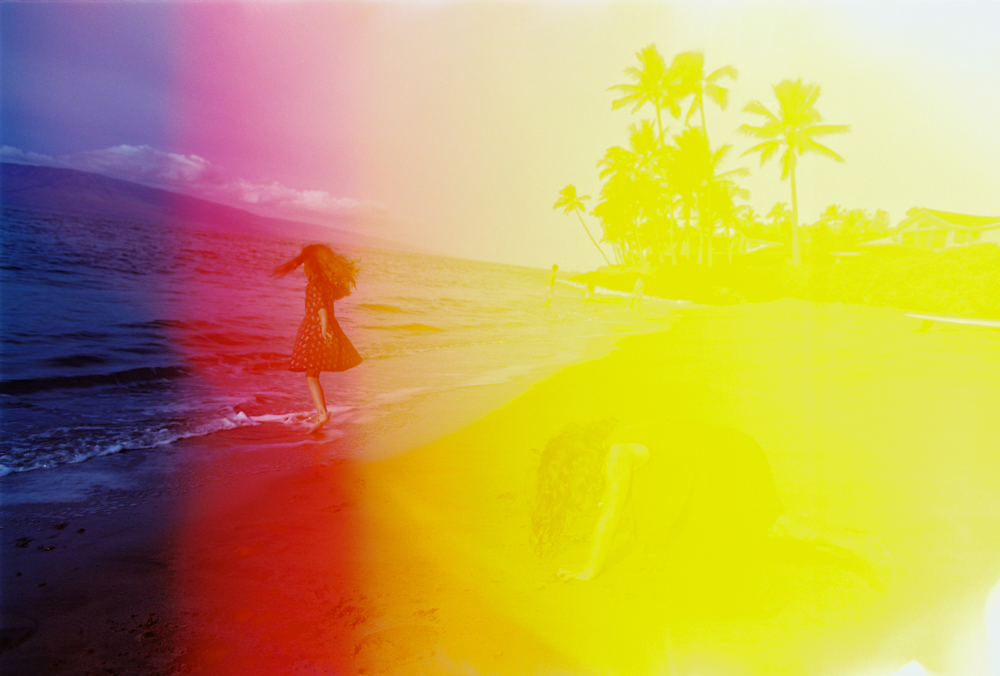 Girl jumping with light leak photo by Hawaii photographer Wendy Laurel