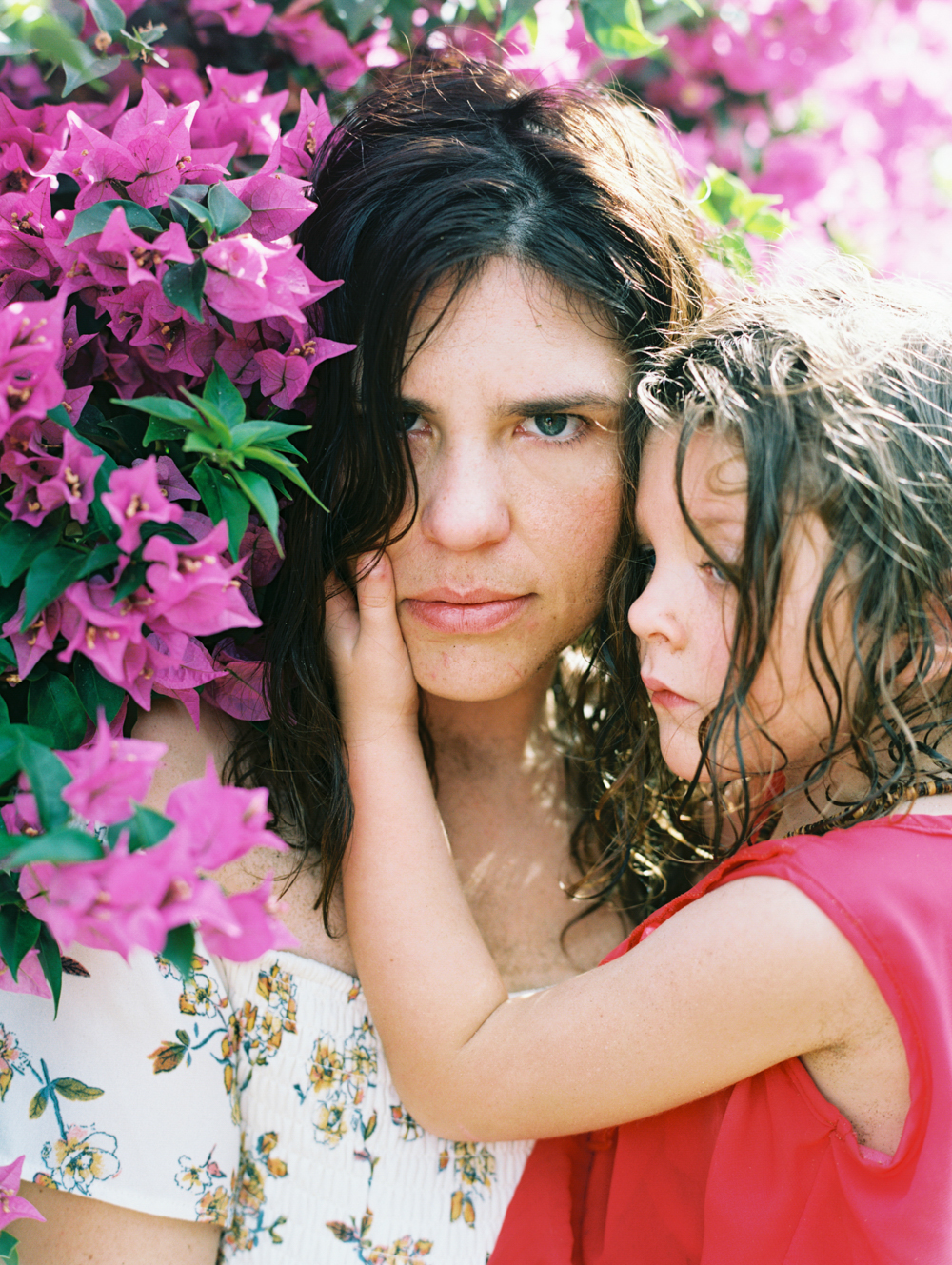 Mom and daughter in bougainvillea by Lahaina family photographer Wendy Laurel