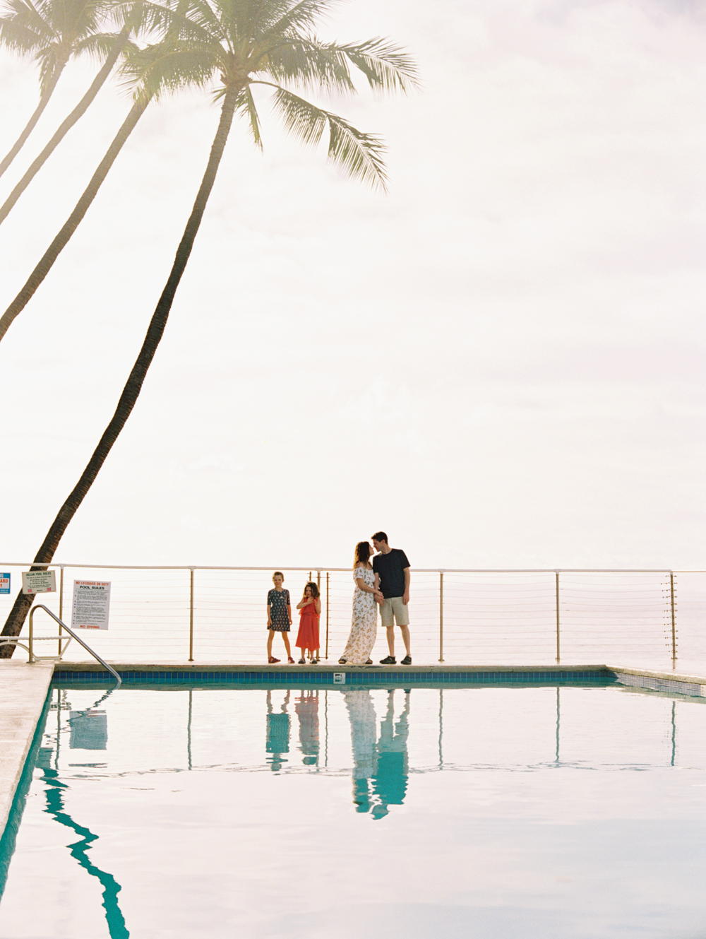 family photo at pool in Puamana by Maui photographer Wendy Laurel