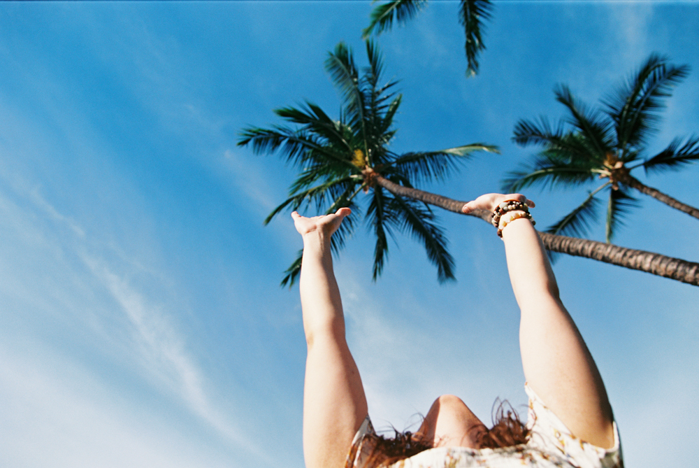 girl reaching for sky photo in Lahaina