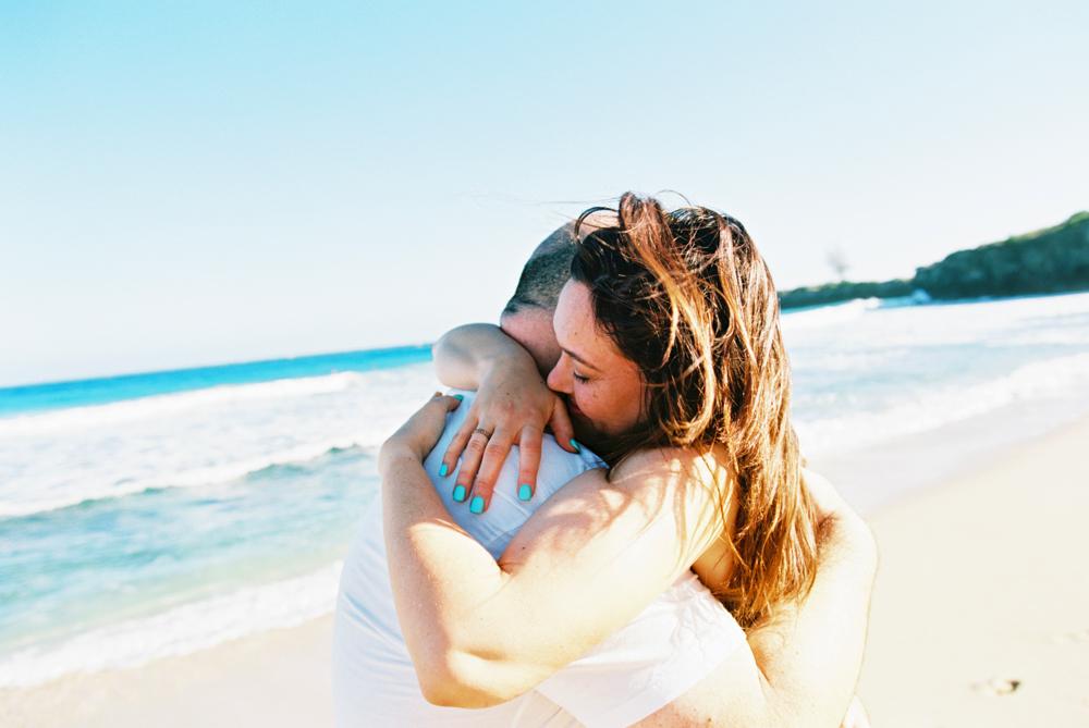 couple hugging at beach in kapalua photograph