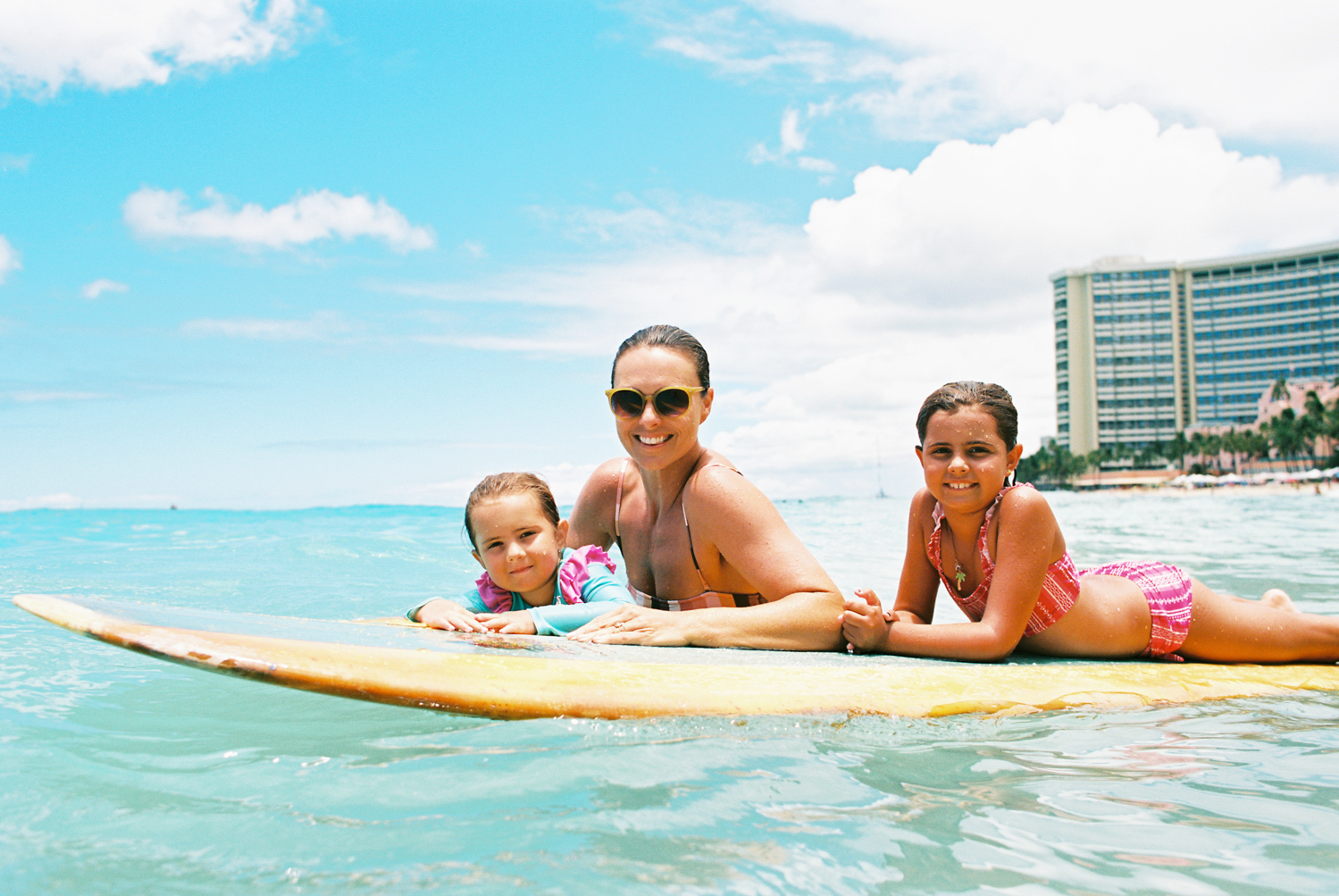 family photograph on surfboard by maui photograper wendy laurel