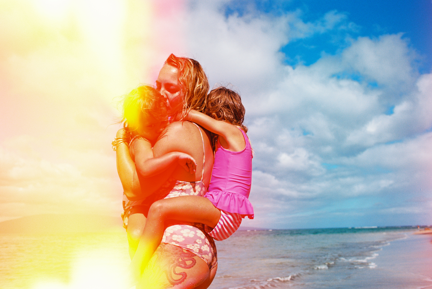 light leaked mom with two daughters on maui beach photo