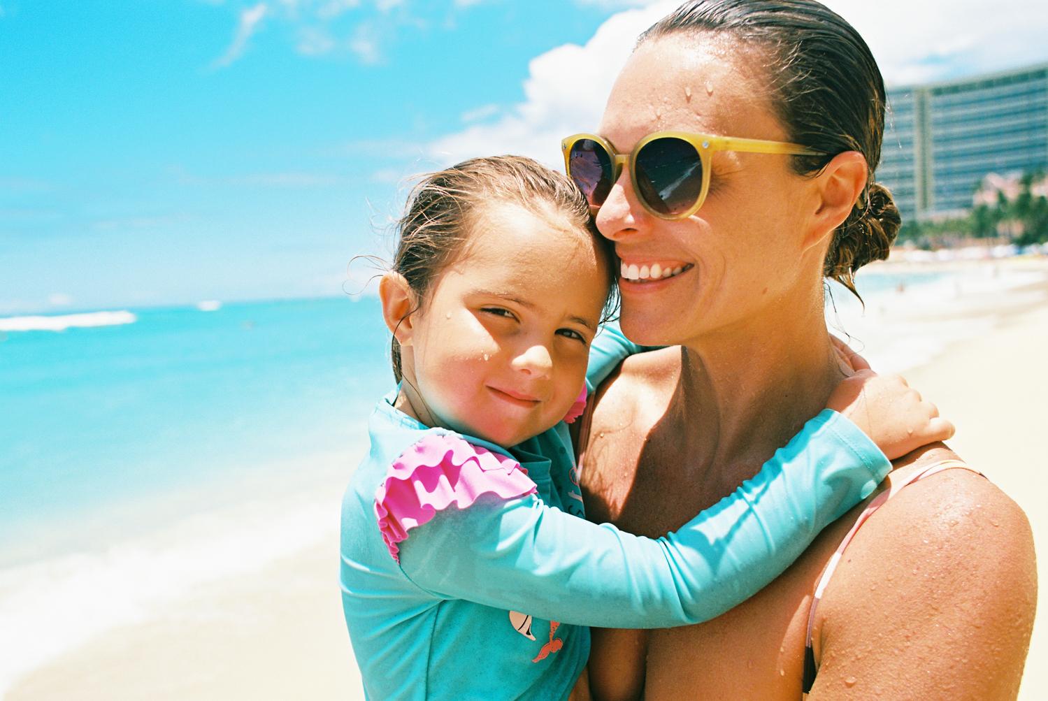 mom and toddler at waikiki beach photograph