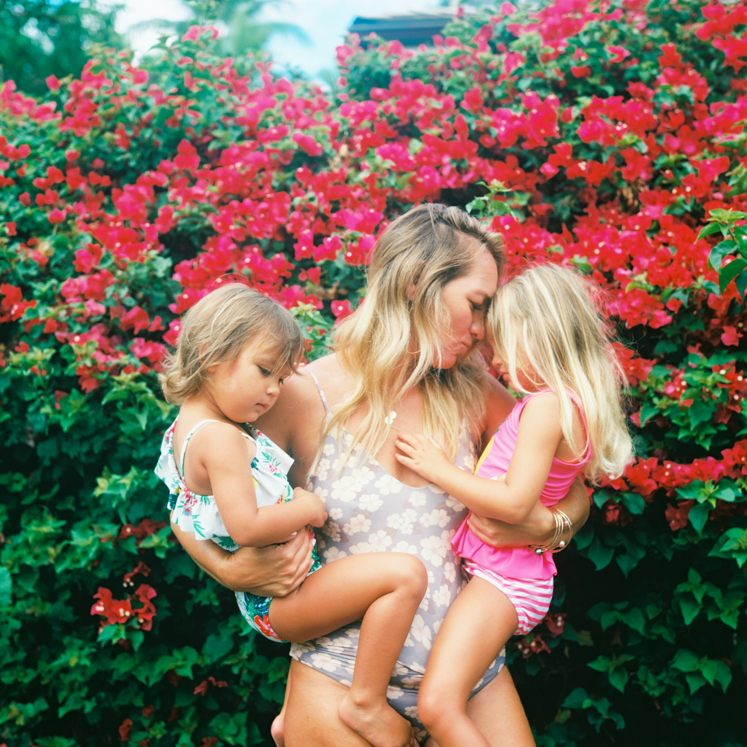 rollei photograph of mom with daughters in front of red bougainvillea